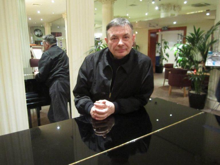 Karl Bartos by a piano